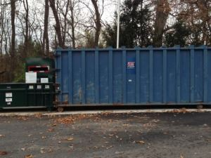 Image of a blue trash dumpster